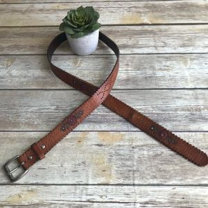 Accessories - Brown scalloped leather belt with floral detail.